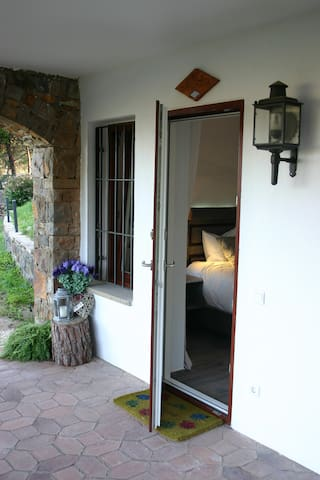 Entrance to the room with a private terrace for the guests.
