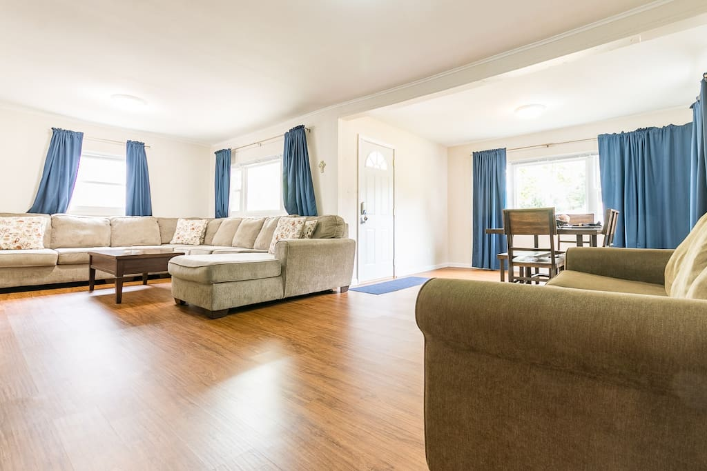 Spacious living area with room for everyone, includes a sleeper sofa.