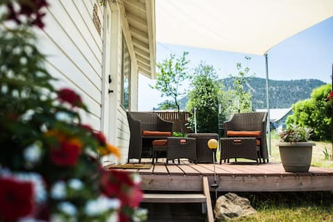 Put your feet up on your own private deck with large shade awning, flowers, and hammock.