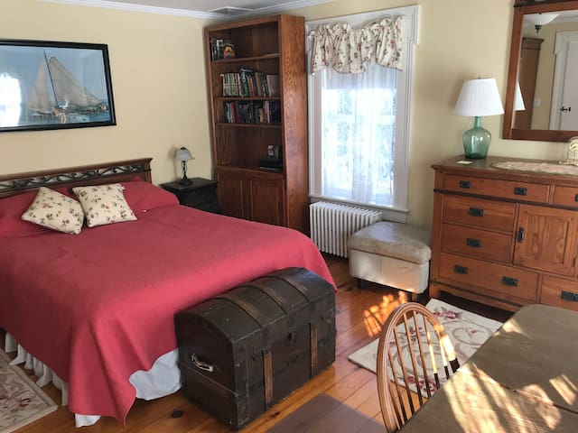 First floor queen sized bedroom, full bathroom is upstairs