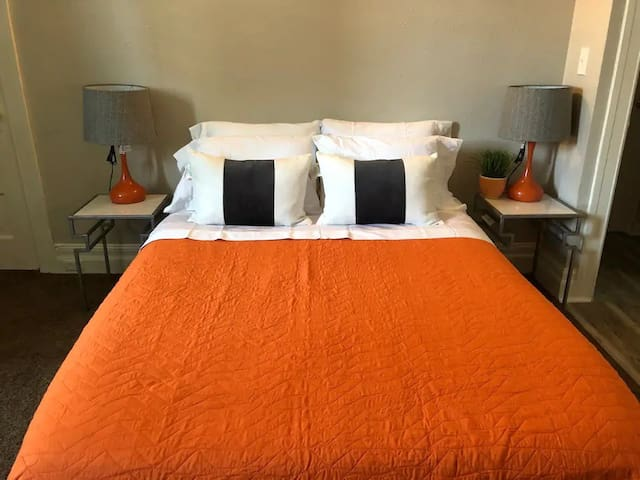 The stylish bedroom offers a comfortable queen bed.
