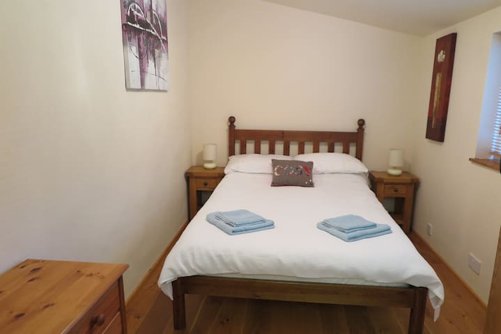 Bedroom with double bed, underfloor heating, dressing table and wardrobe