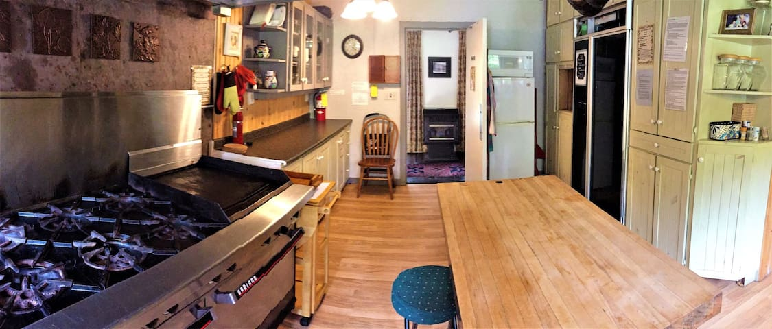 The well equipped shared kitchen offers 1.75 fridges and lots of counter space.