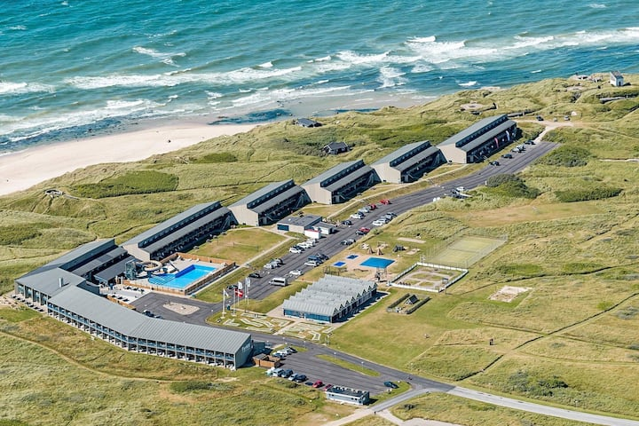 4 person holiday home on a holiday park in Hirtshals