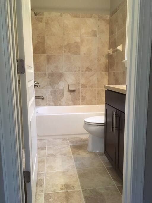 Private bathroom with attached walk-in closet