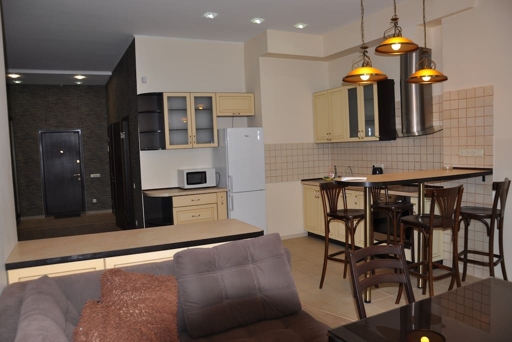 Living area and fully equipped kitchen