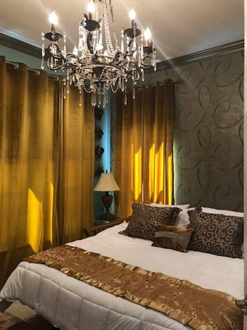 Chandalier with cozy King size bed and private bathroom