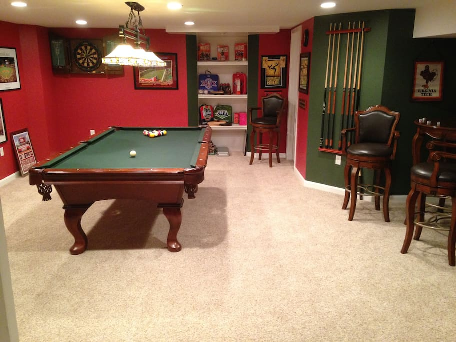 Entertainment room with pool table, darts and refrigerator