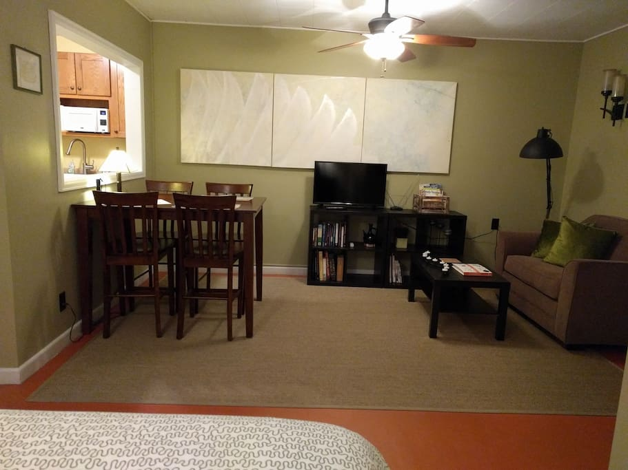 This studio apartment has a table and chairs, sofa bed, queen sized bed, kitchenette, bathroom and lots of amenities!