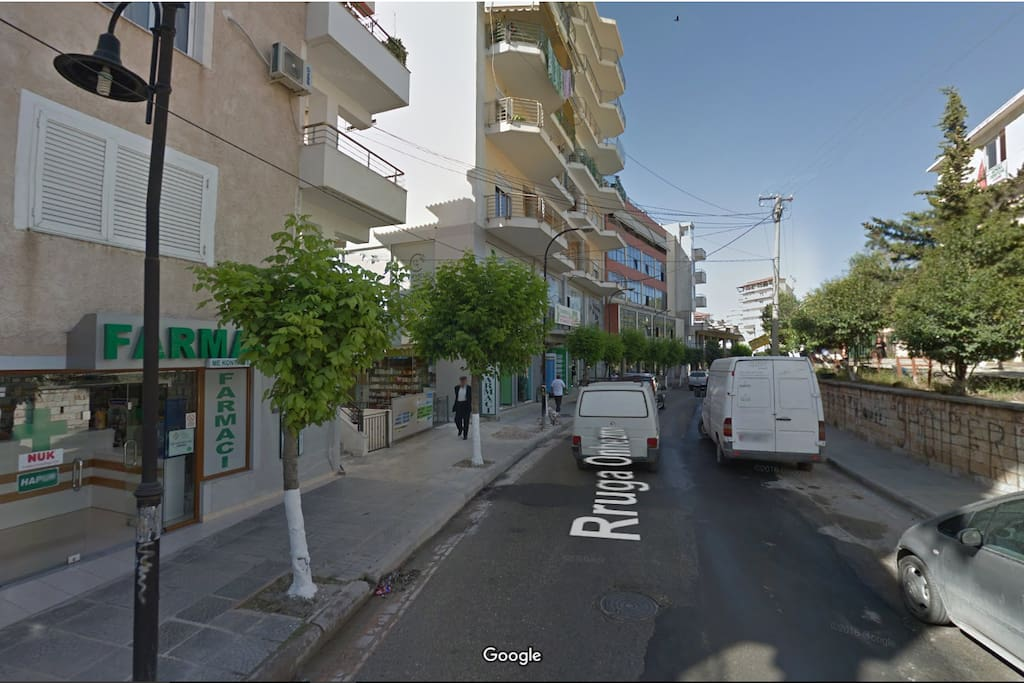 Road view from Maps, Building on the Left, Hospital on the right, Onhezmi Street