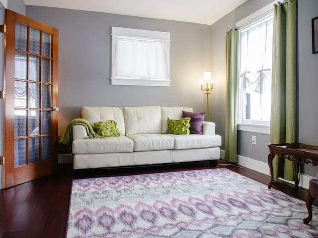 Living room with sofa bed, writing desk, and TV can be closed off for privacy