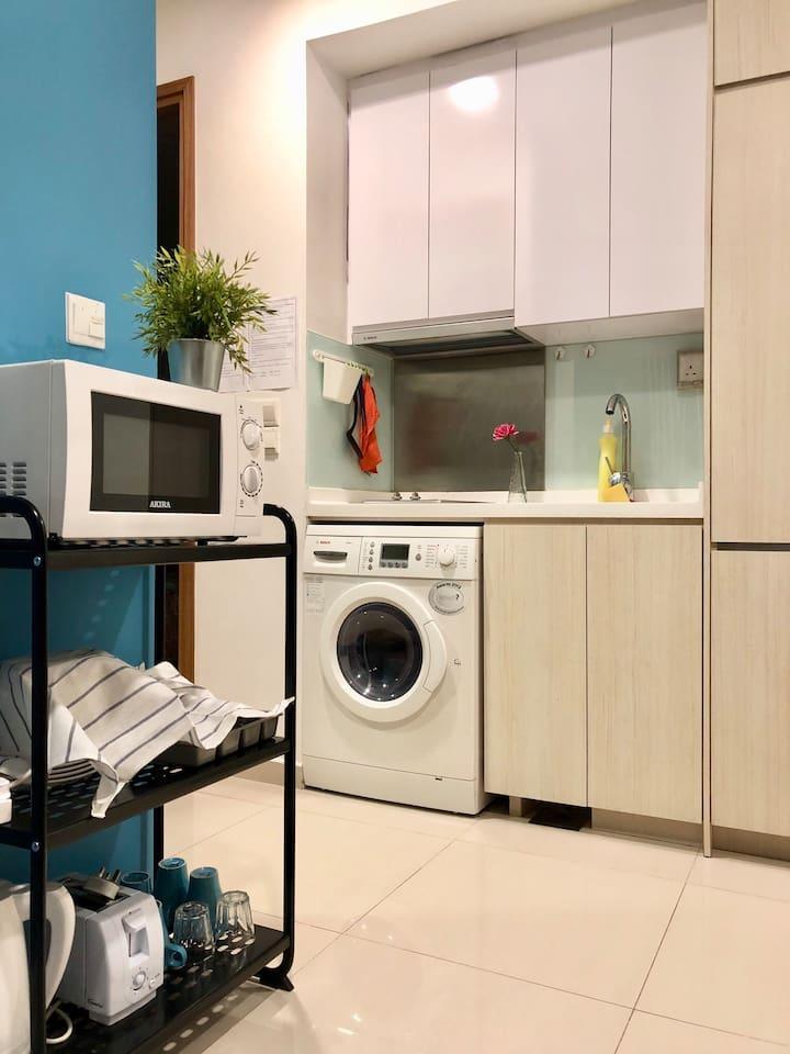 Kitchen area with washing machine & dryer