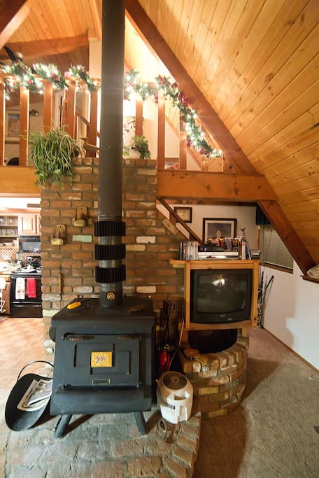 Top-of-the-line wood-burning stove with wood provided.  TV/dvr.
