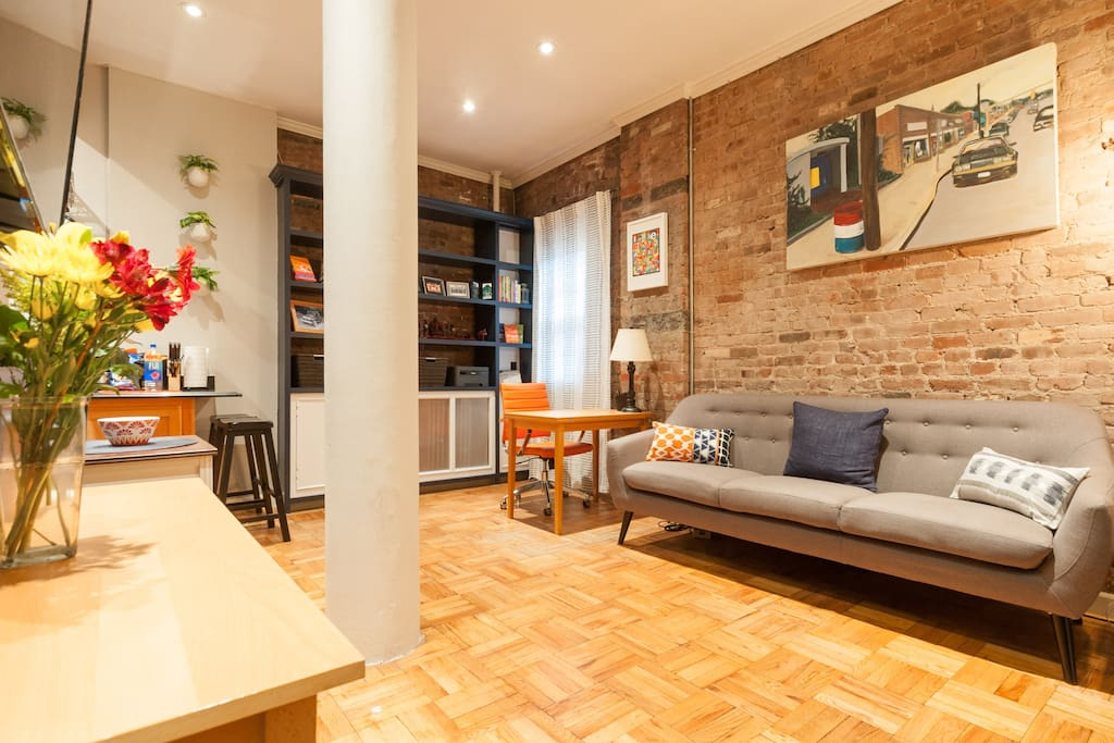 Warm, inviting home with hardwood floors and exposed brick.