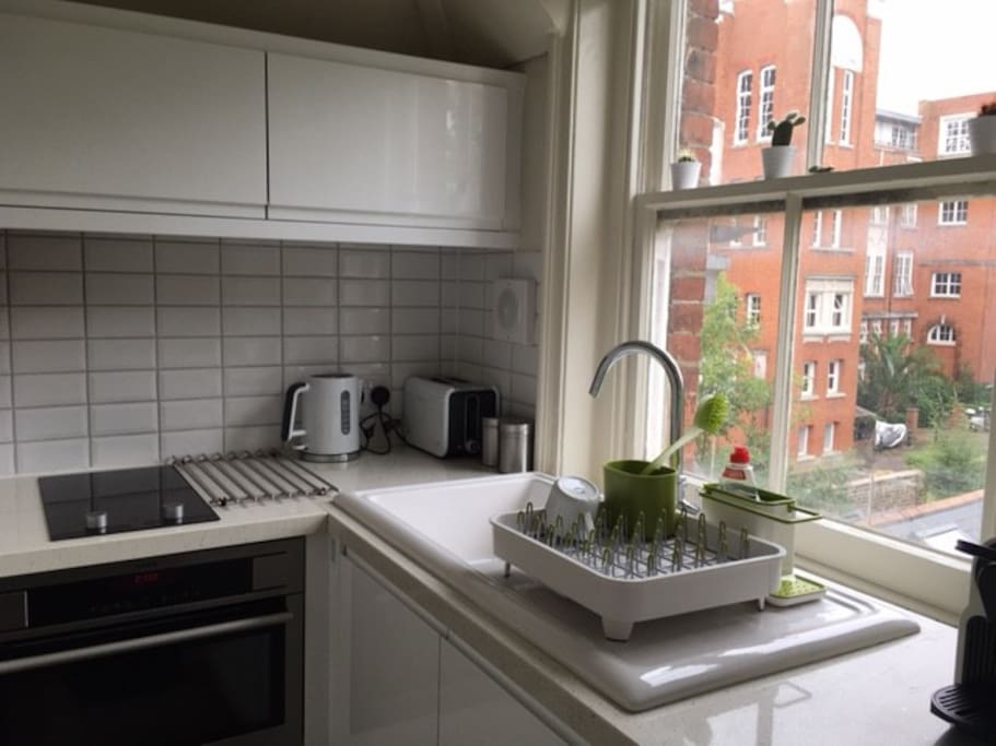 Nifty little kitchen with fridge freezer and combined oven/microwave