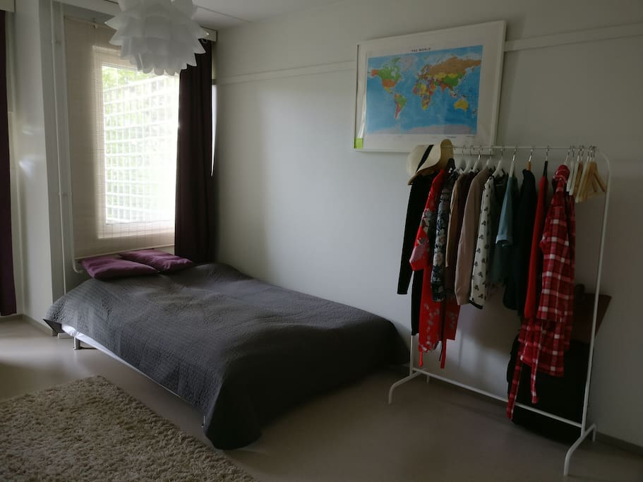 Bedroom has a clothes rack and a map, in case you're lost or searching for your next destination.