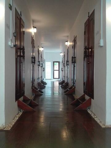 All rooms are placed beside inside corridor.