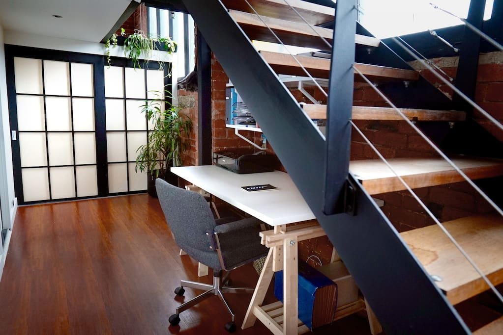 Office space under the stairs. You're welcome to use the printer and stationary.