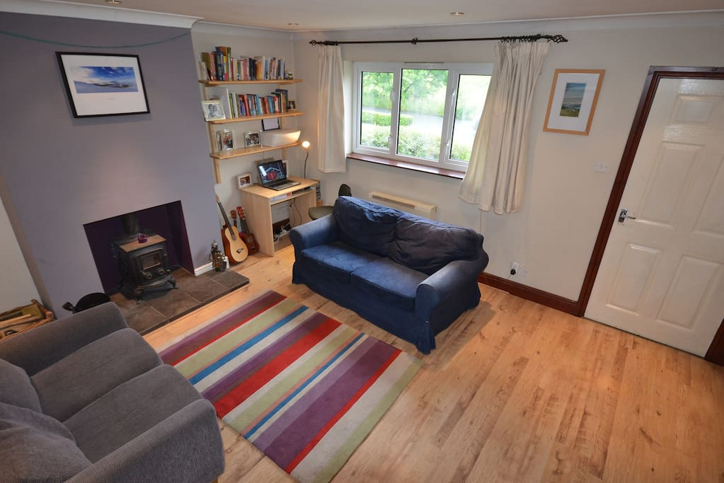 Living room with log burner. walking maps/climbing guides/books available