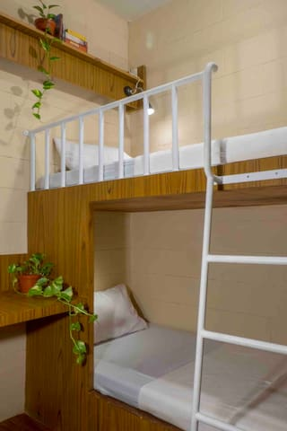 Double bedroom 208. Bunk bed, spacious work table that can accomodate 2 person, clean linen for your stay