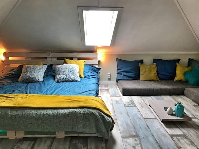 Palletkamer met loungehoek