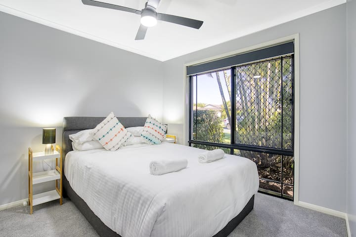 A fourth room comes with a plush queen bed, a ceiling fan and built-in mirrored wardrobes.