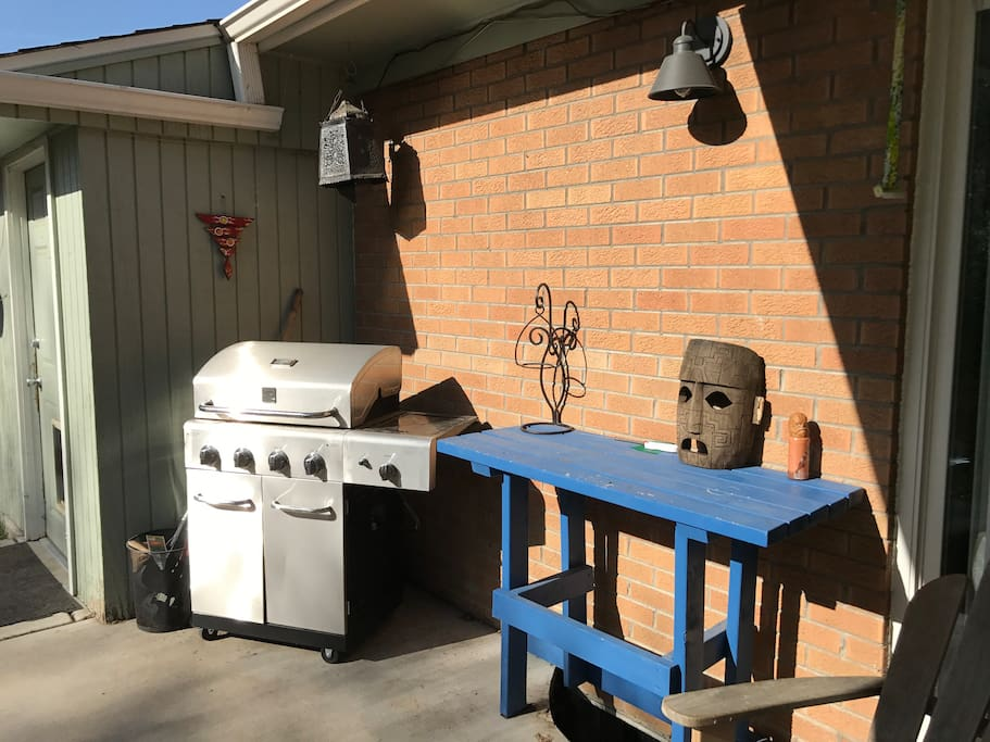 Patio area with gas grill.