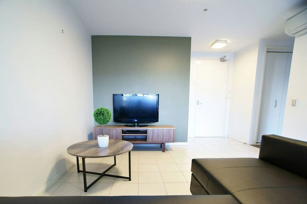 Lounge Room with sofa and TV