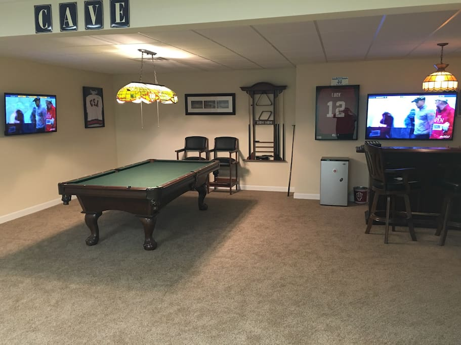Pool table with mounted TVs to watch the Hoosiers!
