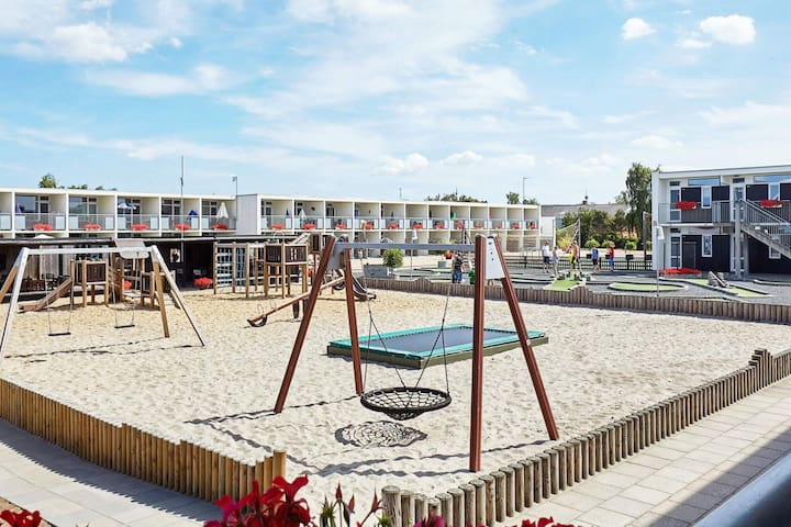6 person holiday home on a holiday park in Glesborg