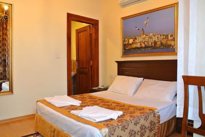 Double bed with private bathroom close blue mosque