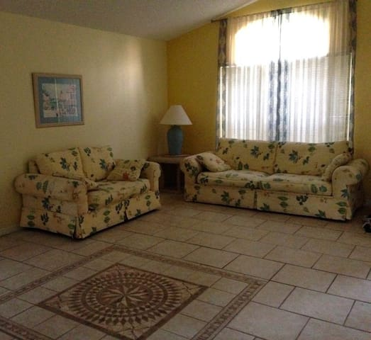 Spacious Family Room with Extendable Couch