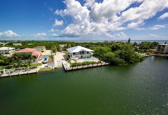 Super Grouper - new, lux 5BR 7BA house with pool and dock