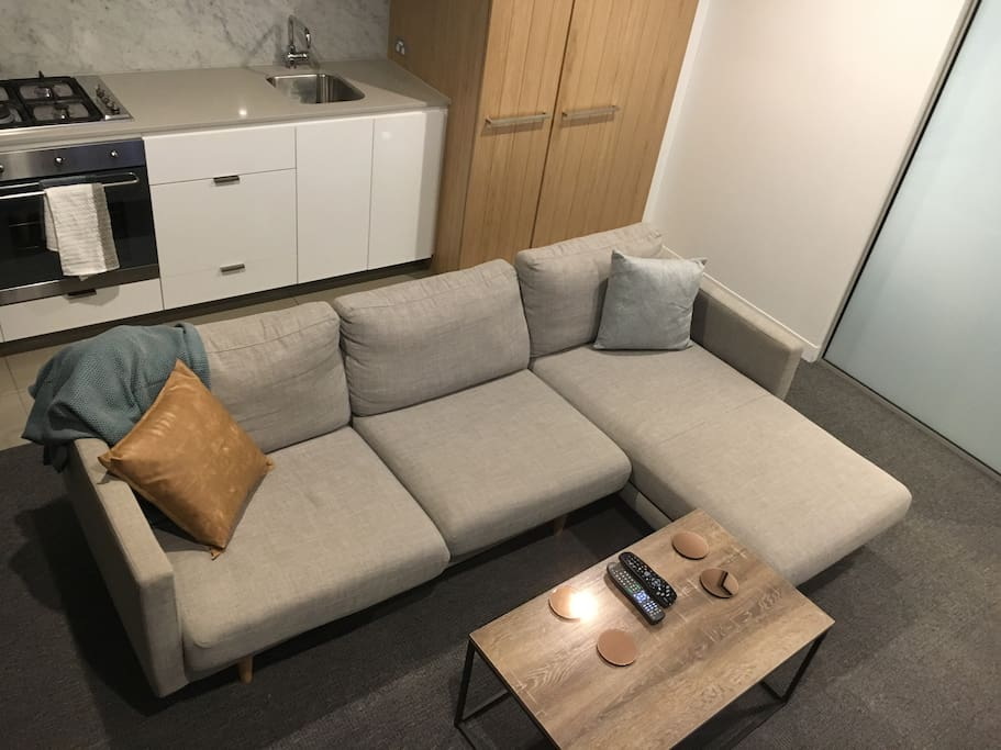 Open plan living with 3 seater designer couch