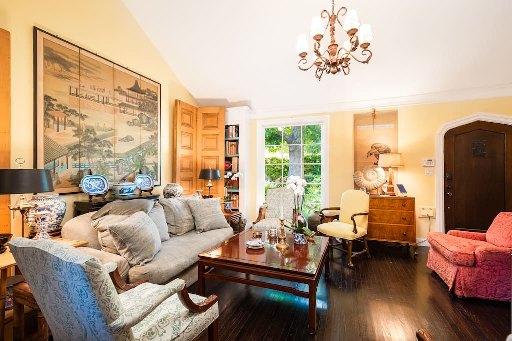 The gorgeous living room features beautiful decor and antique furnishings.