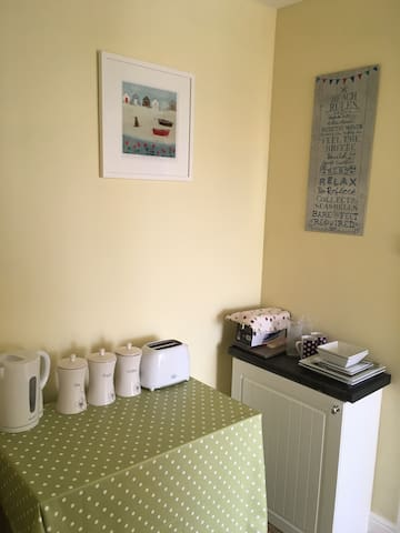 Small bedroom annex with continental breakfast provisions, kettle, toaster, small fridge and utensils