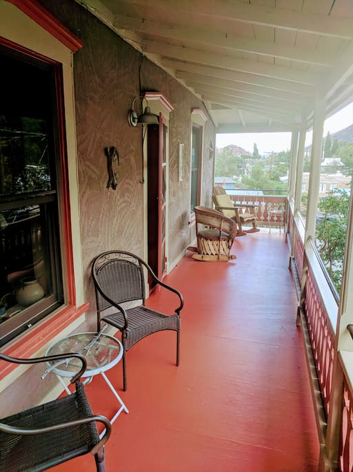 Have a seat and enjoy the view from the balcony of Sun Country Guest House.