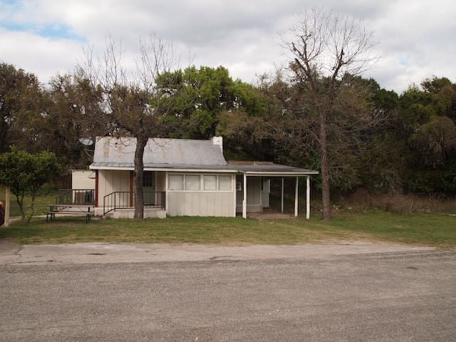 Cabin 49 is on the East side of the Frio River on Hwy 127.