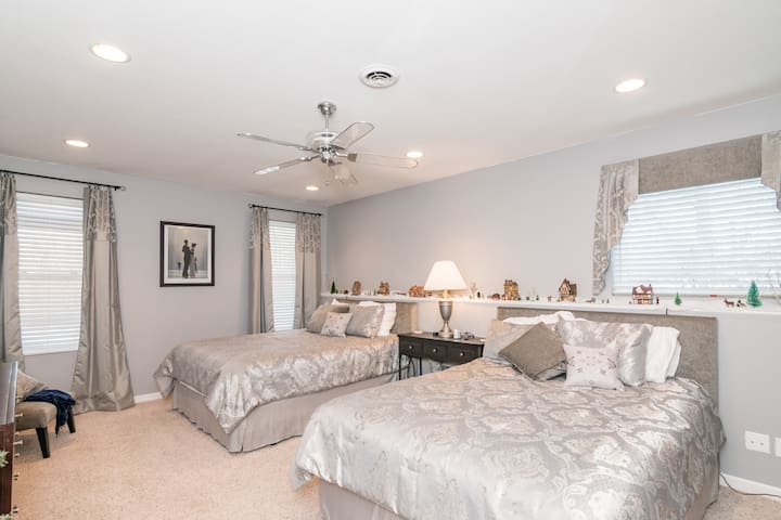 Grey and Luxurious Bedroom Suite, located on the lower floor.  Two queen size beds with bathroom suite attached.    Maximum number of people for this room is 2.