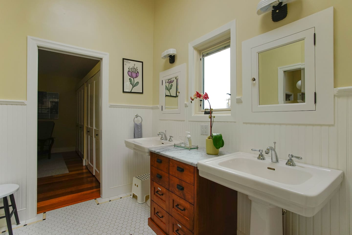 Double sinks with custom craftsman details. Plenty of room to get ready.