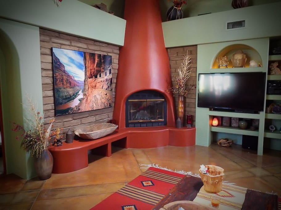 Main house living area also has a fireplace and large tv.