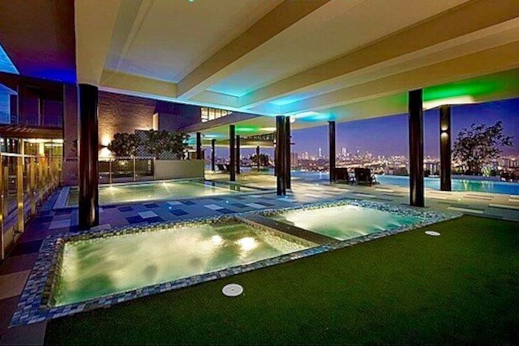 Jacuzzi, spa lounge & infinity swimming pool-night time view