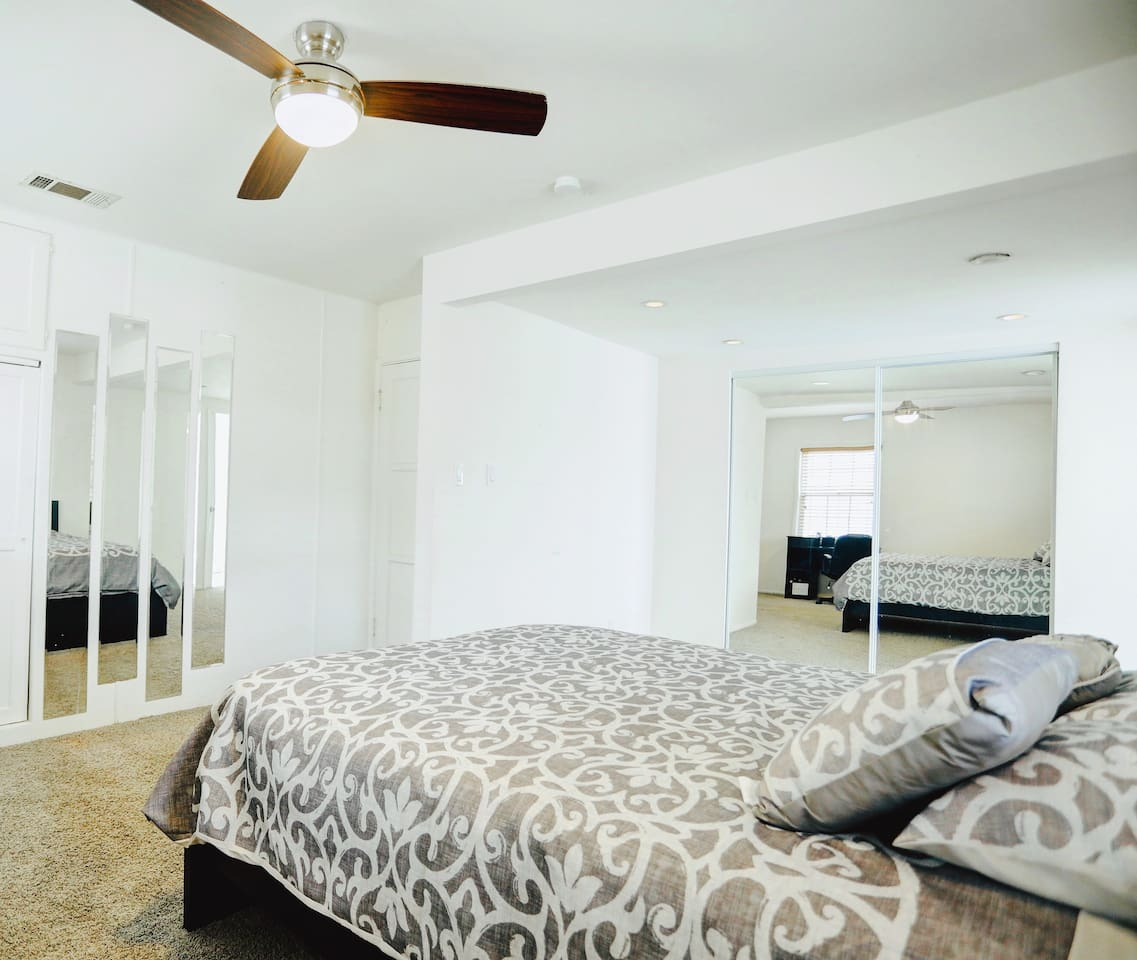 Spacious, clean, neat, cozy master bedroom with comfy Queen size bed with remote control fans and lights . Perfect for two people :)