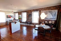 Kitchen bar & dinning room in an open floor plan. Beautiful, exposed brick with lots of natural light.