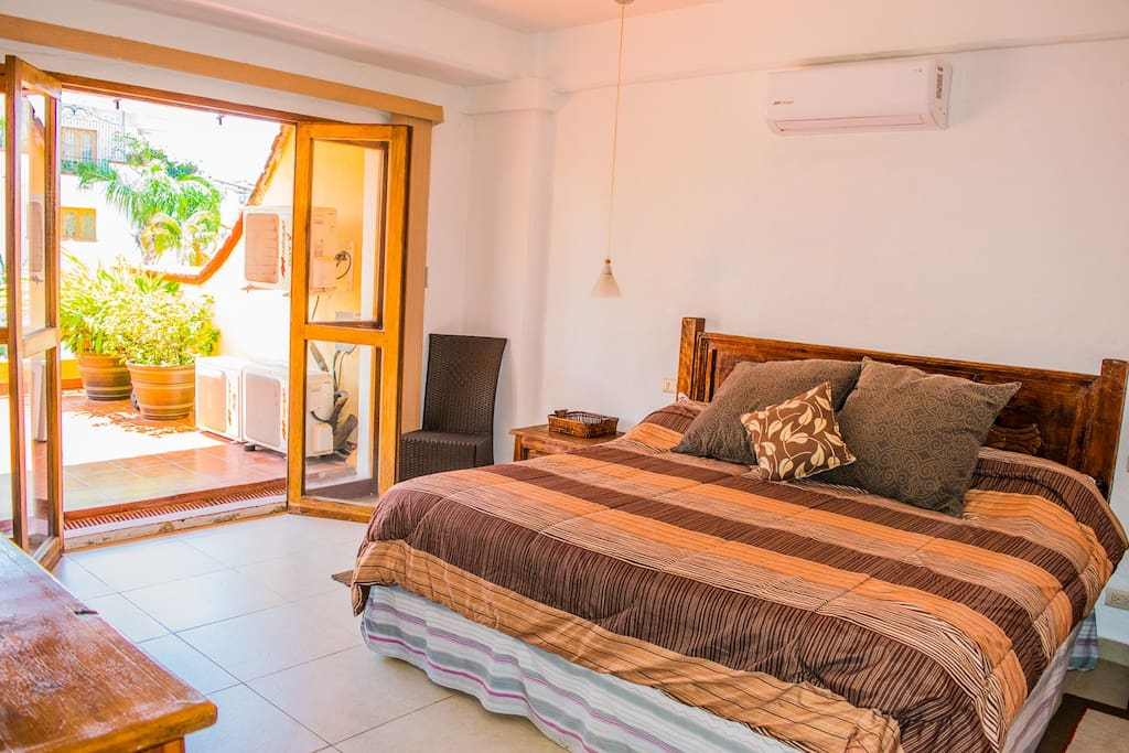 Master bedroom includes a comfortable King Size bed and the room opens right up to the  massive terrace