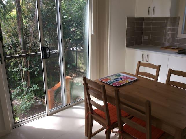 New guest cottage in quiet garden, near transport.