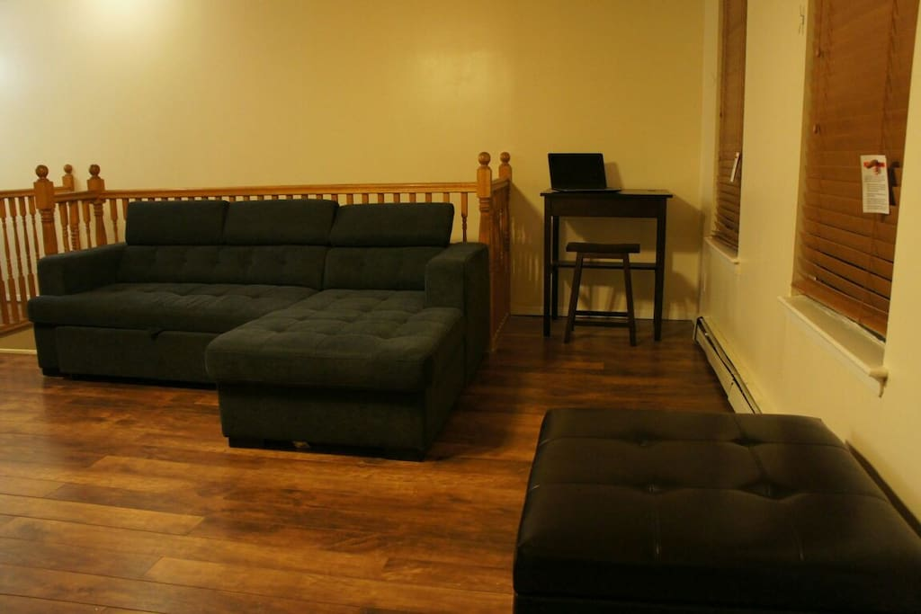Couch that converts to sleep two. Desk and stool with available wifi.