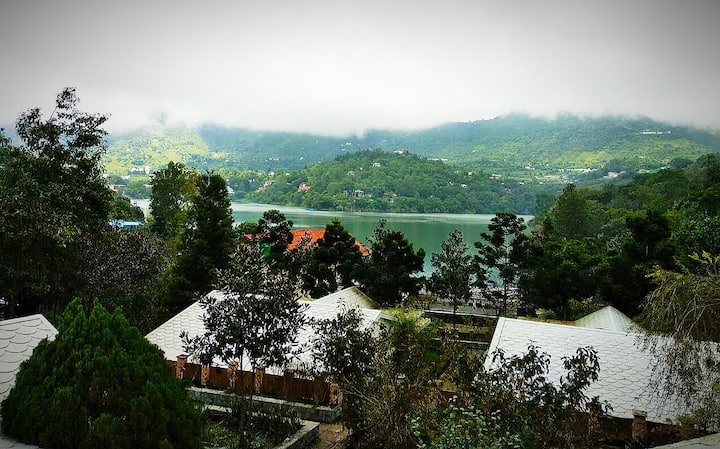 Cottages by the Naukuchiatal Lake