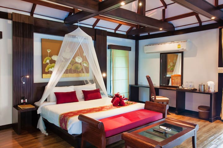 Traditional thai-style bedroom with television, airconditioning