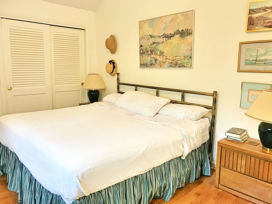 Room #1 (Private bedroom with door) Features: King size bed, hardwood floors, closet, dressers, cable TV, Air conditioning and heating.